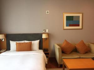Кровать или кровати в номере Somerset Palace Seoul