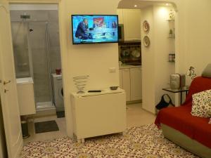 TV in/ali zabaviščno središče v nastanitvi Casa Di Giovanna