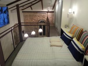 A bed or beds in a room at Best Location Historic Boutique Apartment