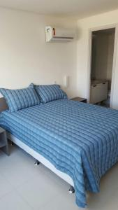 A bed or beds in a room at Beach Class Boa Viagem