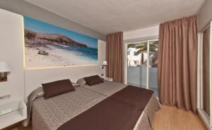 Cama o camas de una habitación en HL Paradise Island