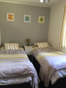 A bed or beds in a room at Creity Hall Chalet