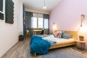 A bed or beds in a room at Apartments Ve Smeckach 27