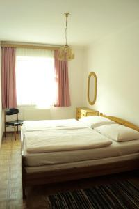 A bed or beds in a room at Apartments Wirrer