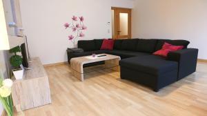 Ein Sitzbereich in der Unterkunft Apartment Nepomuk