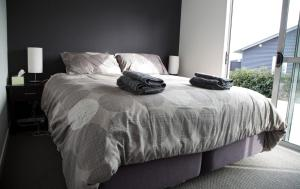 A bed or beds in a room at Ohakune-Matata