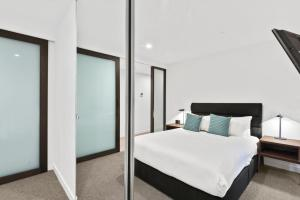 A bed or beds in a room at District South Yarra