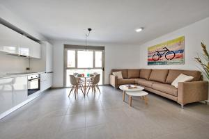 A seating area at Poble Espanyol Apartments