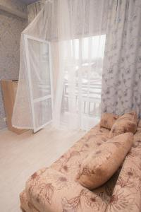 A bed or beds in a room at Sochi Sakvoyage Apartments