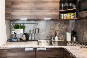 A kitchen or kitchenette at Hampton Suites Serviced Apartments