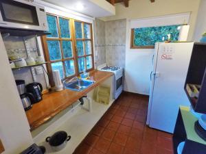 Una cocina o kitchenette en Camino de los Pioneros