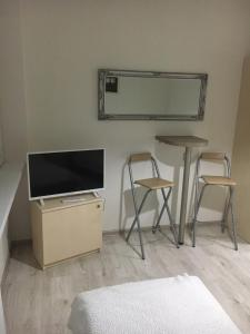 A television and/or entertainment center at Apartman Saris
