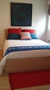 A bed or beds in a room at Residences les roseaux