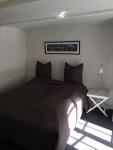 A bed or beds in a room at Nybro Apartments
