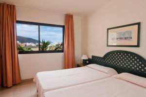 A bed or beds in a room at Apartamentos Baja Del Secreto