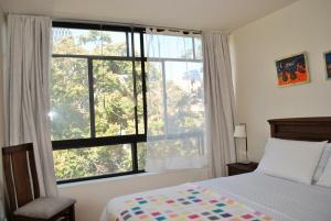 Cama o camas de una habitación en Santo Domingo frente Bellas Artes