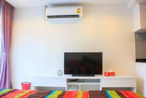 A television and/or entertainment centre at Pixels Condo at Panwa Beach