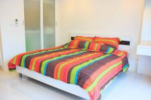 A bed or beds in a room at Pixels Condo at Panwa Beach