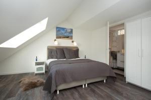 Een bed of bedden in een kamer bij Apartments Valkenisse