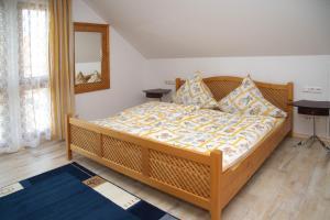 Ein Bett oder Betten in einem Zimmer der Unterkunft Ferienhaus Bauerngarten
