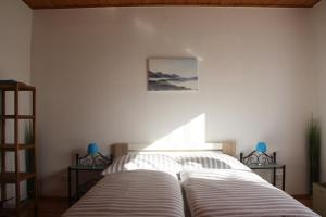 Ein Bett oder Betten in einem Zimmer der Unterkunft Ferienresidenz Casa Monita
