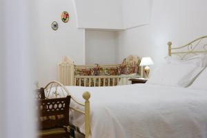 A bed or beds in a room at Palazzo Altavilla