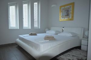 Postel nebo postele na pokoji v ubytování Apartments Lofiel