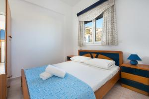 A bed or beds in a room at Sunny Beach