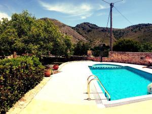 The swimming pool at or near Villa Archodiko