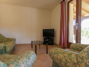 A television and/or entertainment center at Beautiful Holiday home in Masclat with Enclosed Garden