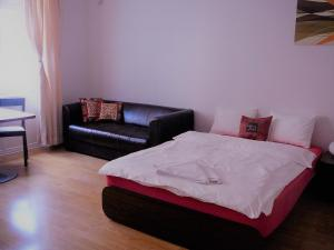 A bed or beds in a room at Apartments Bratislava