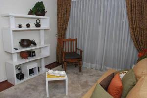 Zona de estar de Puerta Arauco Apartamentos