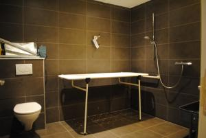 Ein Badezimmer in der Unterkunft Equus