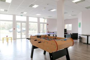 A billiards table at Adonis Hauts De Honfleur