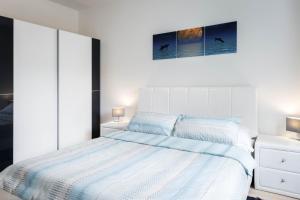 Posteľ alebo postele v izbe v ubytovaní Kalina Apartment