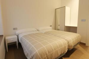 A bed or beds in a room at Jose Maria Soroa
