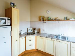 A kitchen or kitchenette at Lovely Holiday Home in Burdaard Netherlands near River