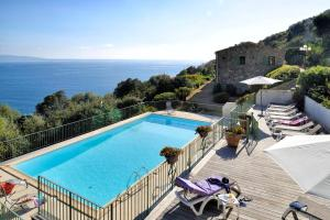 A view of the pool at Residence Roc E Mare Cargèse or nearby