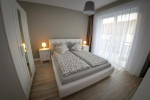Cama ou camas em um quarto em Apartament Dodo