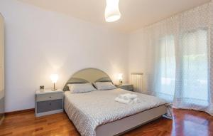 Ein Bett oder Betten in einem Zimmer der Unterkunft Apartment Cuci