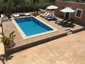 A view of the pool at Villa Sant Jordi or nearby