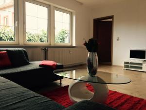 Ein Sitzbereich in der Unterkunft Ferienwohnung in Domnähe