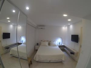 A bed or beds in a room at The Place Leblon
