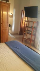 A bed or beds in a room at Apart Hotel Porta Westfalica