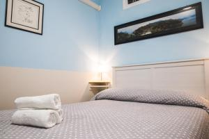 A bed or beds in a room at U Camin