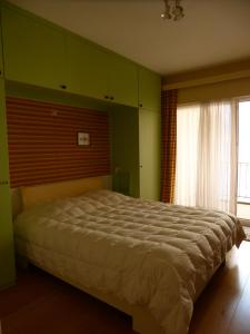 A bed or beds in a room at Family Apartment Knokke