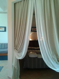 A bed or beds in a room at Residence La Vela - Residenza d'Epoca