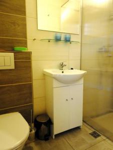 Um banheiro em ACE Apartment