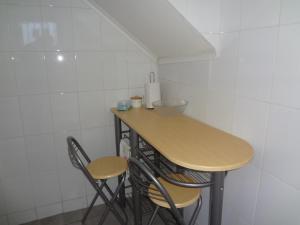 Una cocina o zona de cocina en Cabañas del Puerto