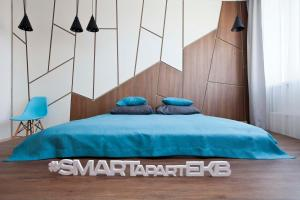 A bed or beds in a room at Smart Apart at Artek